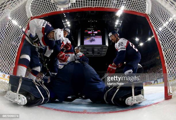 Johnny Gaudreau of USA slides into the net during the 2017 IIHF Ice Hockey World Championship game between Slovakia and USA at Lanxess Arena on May...