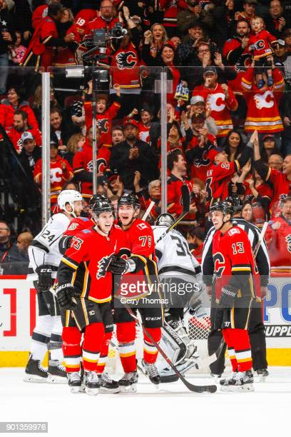 Johnny Gaudreau Sean Monahan and teammates of the Calgary Flames celebrate in an NHL game on January 4 2018 at the Scotiabank Saddledome in Calgary...