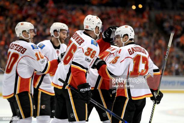Johnny Gaudreau Troy Brouwer Kris Versteeg and Sean Monahan of the Calgary Flames celebrate a goal during the second period of Game Two of the...