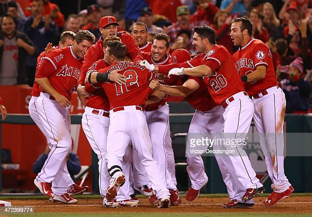 Johnny Giavotella of the Los Angeles Angels of Anaheim is mobbed by teammates after Giavotella hit the gamewinning rbi double to right in the ninth...
