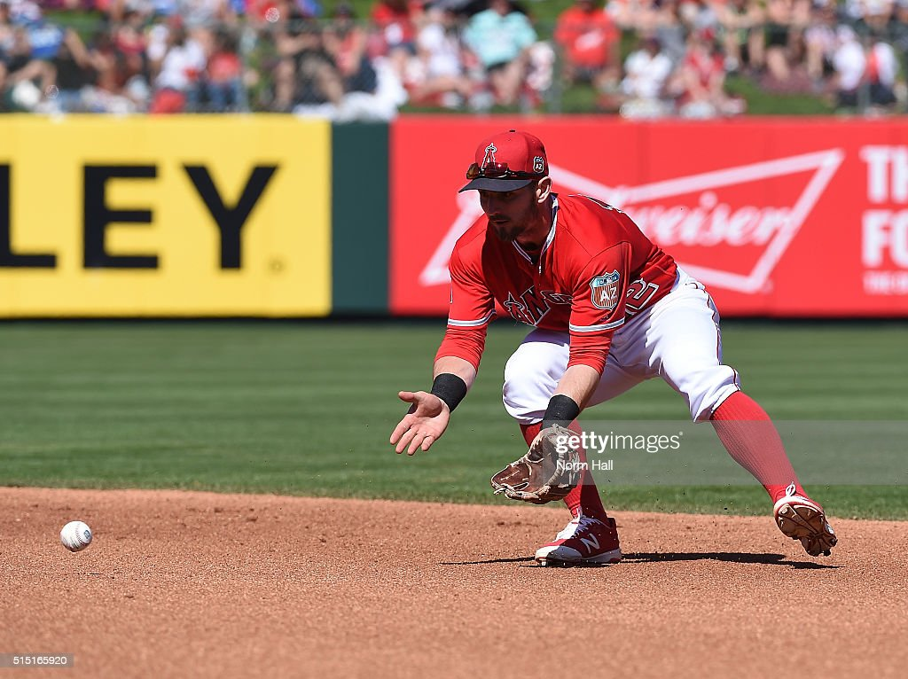 Johnny Giavotella #12 of the Los Angeles Angels of Anaheim makes a play on a ground ball during the fourth inning against the San Francisco Giants at Tempe Diablo Stadium on March 12, 2016 in Tempe, Arizona.