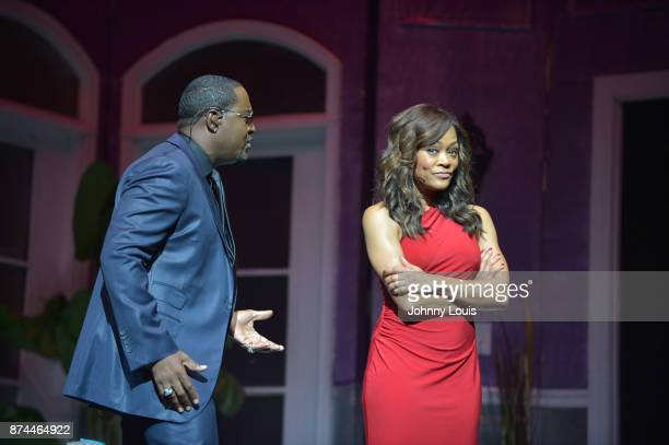 Johnny Gill and Robin Givens perform onstage during Priest Tyaire Productions Momma's Boy stage play day 1 at James L Knight Center on November 11...