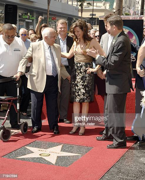 Johnny Grant Honorary Mayor of Hollywood Amy Grant and Leron Gubler president of the Hollywood Chamber of Commerce attend the unveiling of Amy...