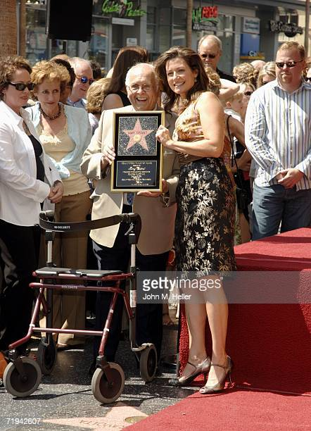 Johnny Grant Honorary Mayor of Hollywood and Amy Grant pose at the unveiling of her star on The Hollywood Walk of Fame September 19 2006 in Hollywood...