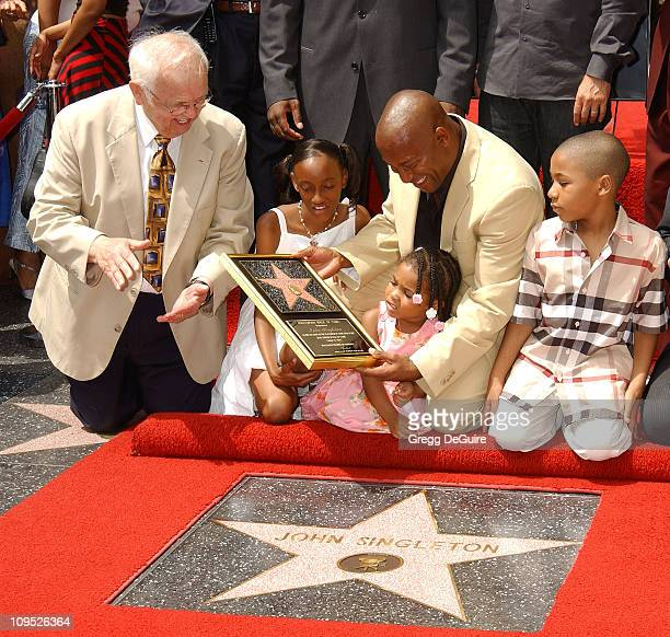 Johnny Grant honorary mayor of Hollywood chairman of the Walk of Fame with John Singleton his kids Justice Cleo Massai