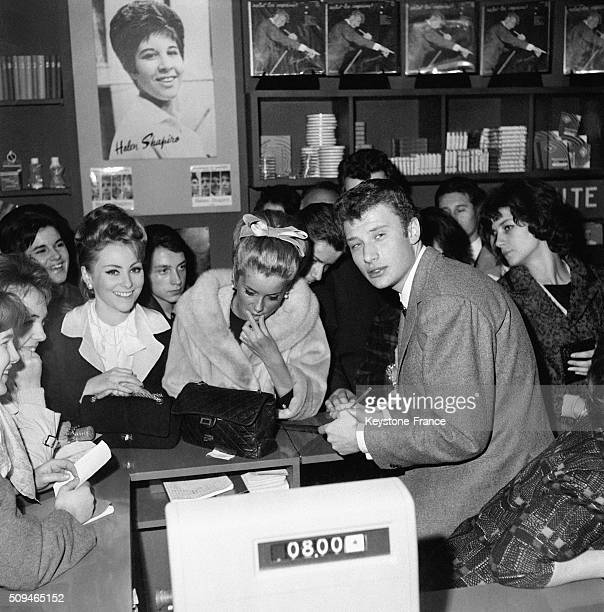 Johnny Hallyday And Catherine Deneuve At A Record Dealer For The Release Of the Movie 'Les Parisiennes' 'Tales Of Paris' In Paris France on January...