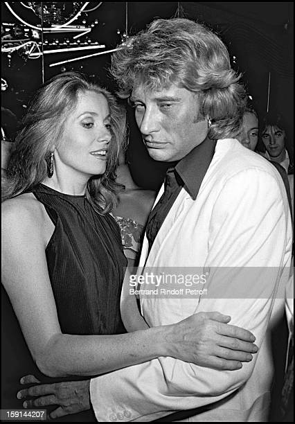 Johnny Hallyday and Catherine Deneuve attend Hallyday's 38th birthday party at the Elysee Matignon night club in Paris in 1981