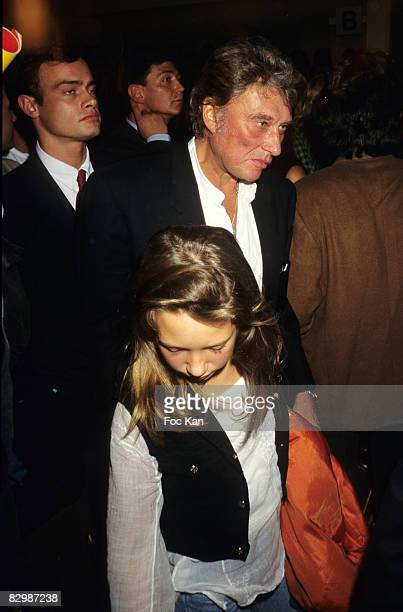 Johnny Hallyday and daughter Laura Smet attend the Katoucha Niane Spring/Summer 1994/1995 Ready To Wear Show at the Salle Wagram on October 01 1994...