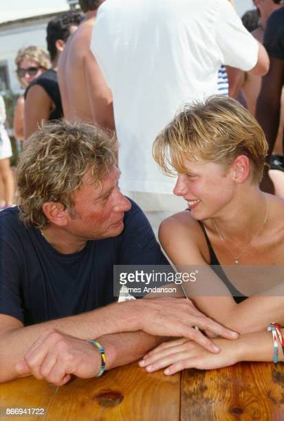 Johnny Hallyday and his fiancee Leah on the beach at the Aqua Party in Saint Tropez 14th July 1988