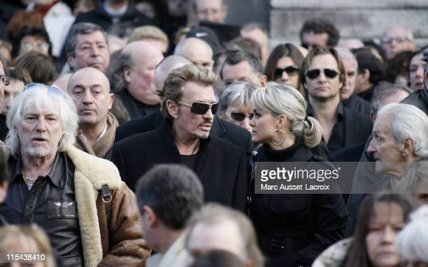 Johnny Hallyday and his wife Laeticia leave the St Germain church after the funeral mass of French singer Carlos on January 22 2008 in Paris France