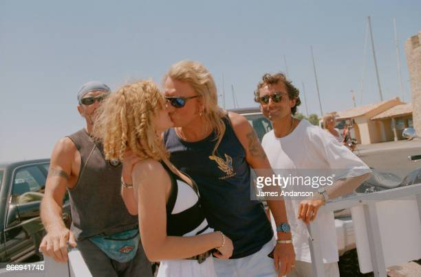 Johnny Hallyday and his wife Laetitia on the port in Saint Tropez 1st July 1996