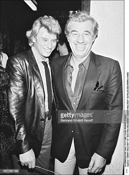 Johnny Hallyday and JeanPaul Belmondo in Johnny's dressing room the night of his concert in Palais Des Sports Paris