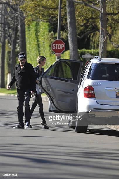 Johnny Hallyday and wife Laetitia test drive a Mercedes sport utility vehicle on January 5 2010 in Los Angeles California