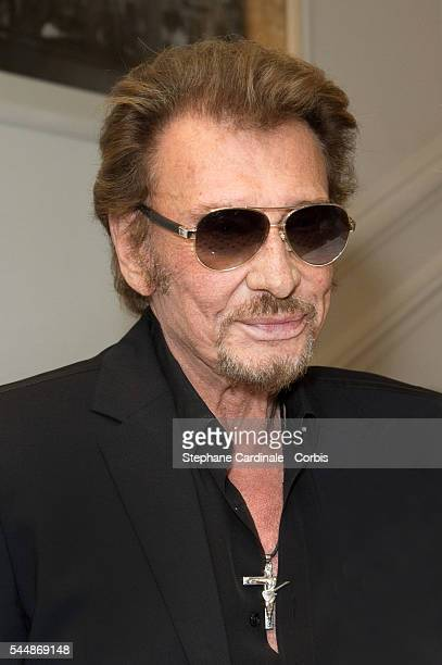 Johnny Hallyday attends the Christian Dior Haute Couture Fall/Winter 20162017 show as part of Paris Fashion Week on July 4 2016 in Paris France