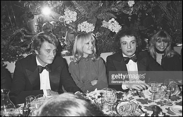 Johnny Hallyday Babette Sardou and Michel Sardou attend birthday party of Michel Sardou at Elysse Matignon night club in 1978