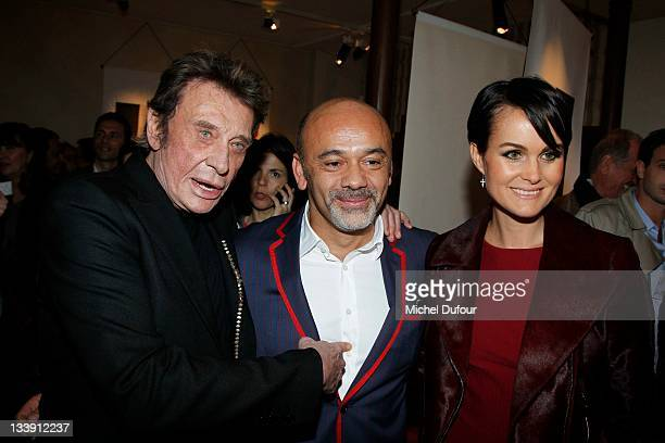 Johnny Hallyday Christian Louboutin and Laeticia Hallyday attend the Christian Louboutin 20th Anniversary Book Launch Cocktail on November 21 2011 in...