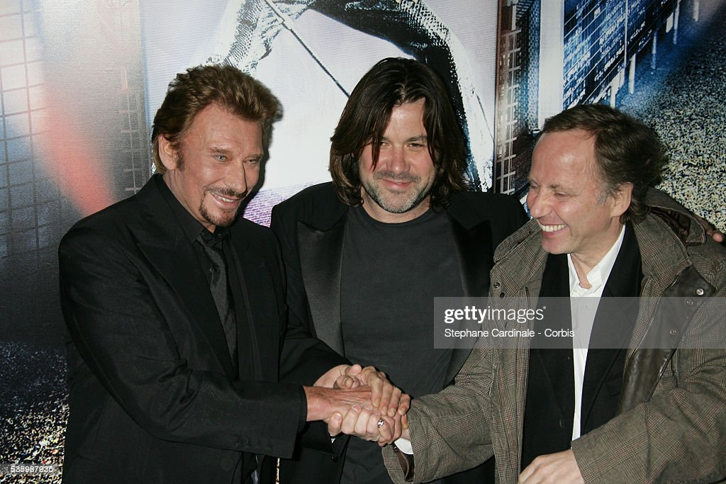 Johnny Hallyday, director Laurent Tuel and Fabrice Lucchini attend the premiere of 'Jean-Philippe' in Paris.
