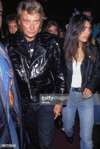 Johnny Hallyday et Adeline Blondieau lors d'une soirée au Palace le 15 septembre 1989 à Paris France