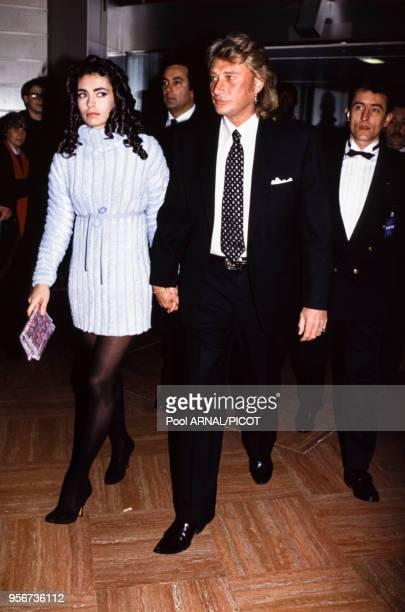 Johnny Hallyday et Adeline Blondieau lors d'une soirée en février 1993 à Paris France