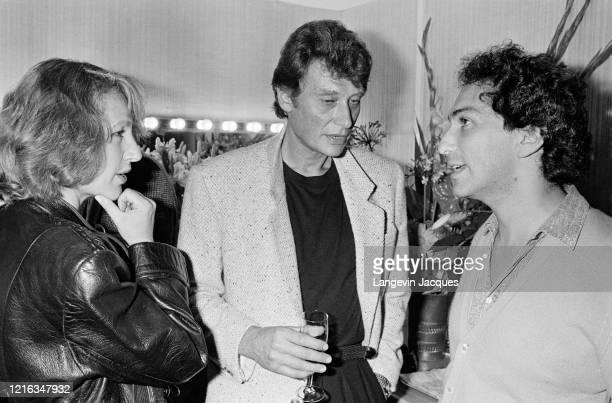 Johnny Hallyday et Nathalie Baye sont venus assister à la première du concert de France Gall au Zénith de Paris. Ici avec le mari de la chanteuse :...