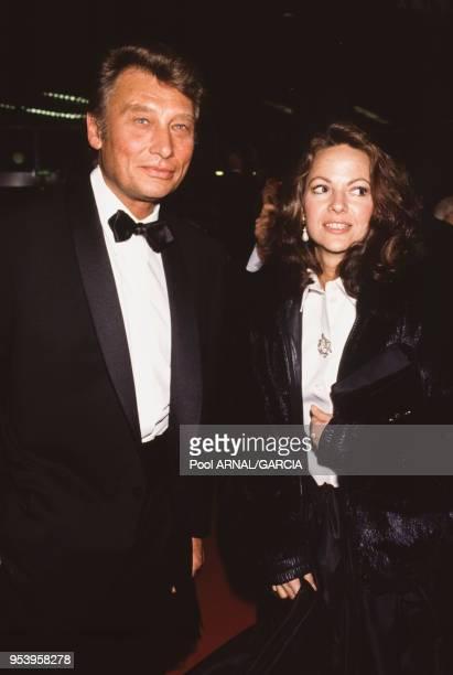 Johnny Hallyday et sa compagne Gisèle Galante lors de la cérémonie des Césars à Paris le 12 mars 1988 France