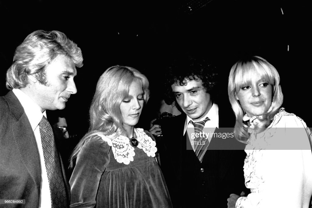 johnny hallyday et sylvie vartan felicitent les maries michel sardou news photo getty images. Black Bedroom Furniture Sets. Home Design Ideas