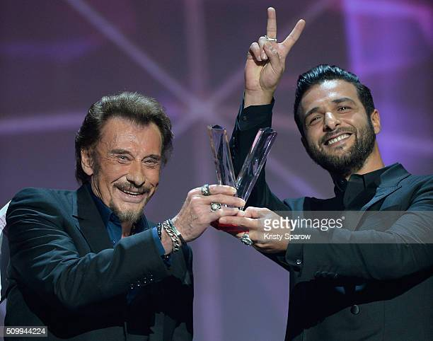 Johnny Hallyday excepts the award for Best Singing Album for 'De l'amour' with Yodelice during the 31st 'Victoires de la Musique' French Music Awards...