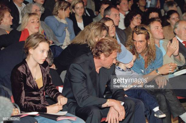 Johnny Hallyday his daughter Laura Smet and Filip Nikolic attend Leonard's fashion show where Laeticia Hallyday is parading Paris 19th October 1997