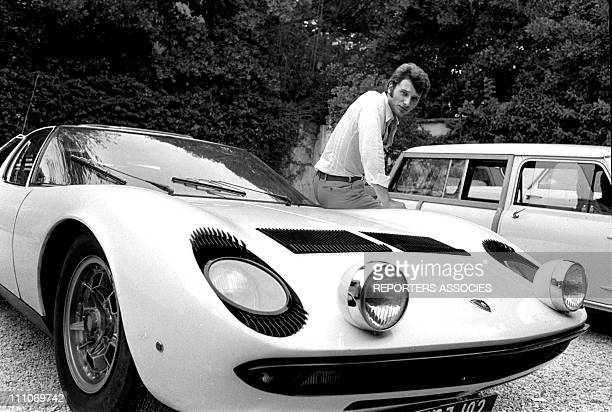 Johnny Hallyday in the sixties in France Johnny Hallyday and his Lamborghini Miura on the French Riviera in France on August 27 1967