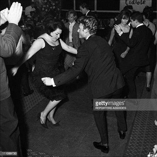 Johnny Hallyday in the sixties in France Johnny Hallyday is dancing with Regine in France in the sixties