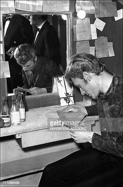 Johnny Hallyday in the sixties in France Premiere of Johnny Hallyday show Johnny reading a telegram in France on February 07 1964