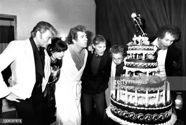 Johnny Hallyday, Muriel Bailleul, Eddy Mitchell, Hugues Aufray, Pierre Richard et Mort Shuman à Paris le 21 novembre 1980, France.