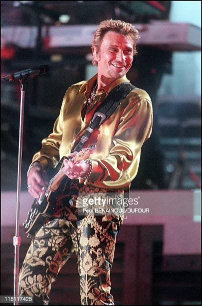 Johnny Hallyday on stage at the foot of the Eiffel Tower in Paris France on June 10 2000