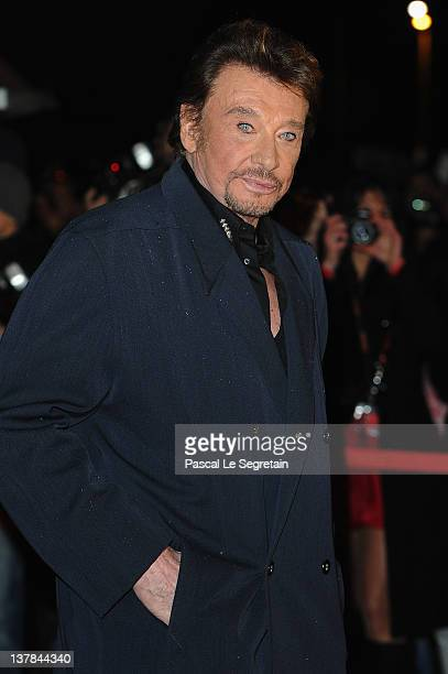 Johnny Hallyday poses as he arrives at NRJ Music Awards 2012 at Palais des Festivals on January 28 2012 in Cannes France