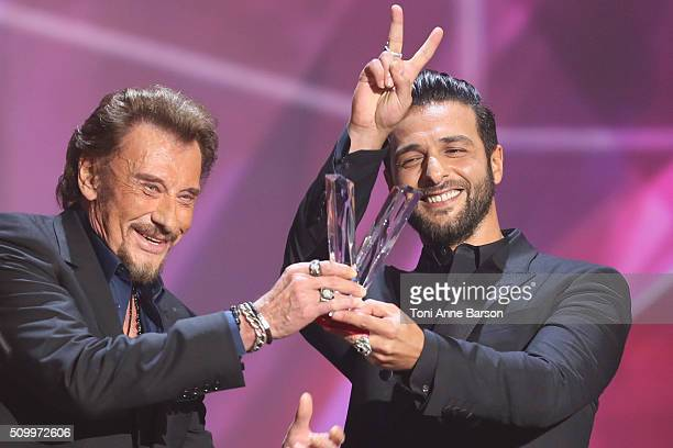 Johnny Hallyday receives an award and Maxime Nucci during Les Victoires De La Musique at Le Zenith on February 12 2016 in Paris France