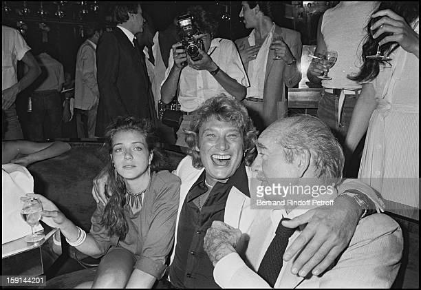 Johnny Hallyday Sabrina and Eddie Barclay celebrate Hallyday's 38th birthday at the Elysee Matignon night club in Paris in 1981