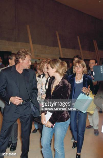Johnny Hallyday with his daughter Laura Smet and his wife Laeticia Hallyday arriving at the fashion show Laeticia Hallyday is accompanied by her...