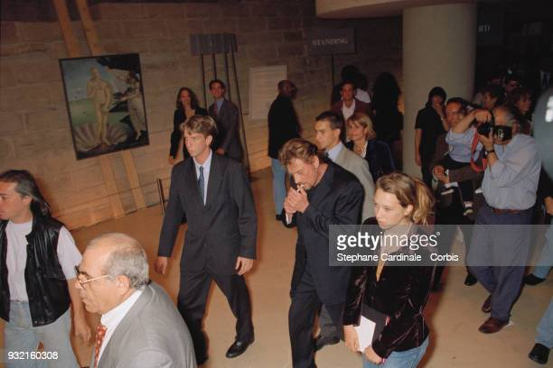 Johnny Hallyday with his daughter Laura Smet and his wife's family arriving at the fashion show Laeticia Hallyday's mother Françoise Thibaut her...