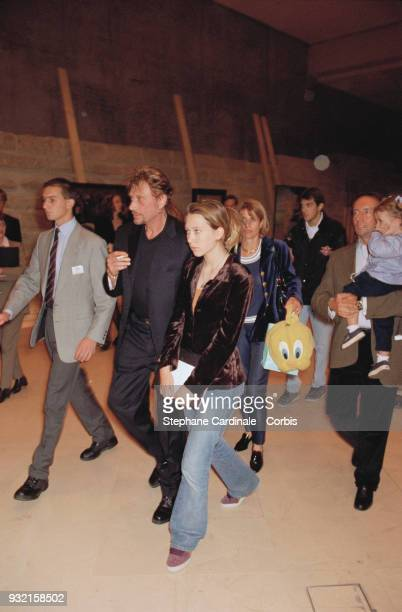Johnny Hallyday with his daughter Laura Smet arriving at the fashion show Françoise Thibaut her husband and daughter Margaux Thibaut are accompanying...