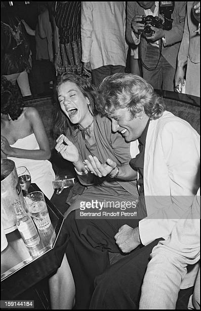 Johnny Hallyday with his friend Sabine celebrates his 38th birthday at the Elysee Matignon night club in Paris in 1981