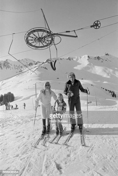Johnny Hallyday with his wife Sylvie Vartan and his son David Hallyday on a ski trip, January 1974