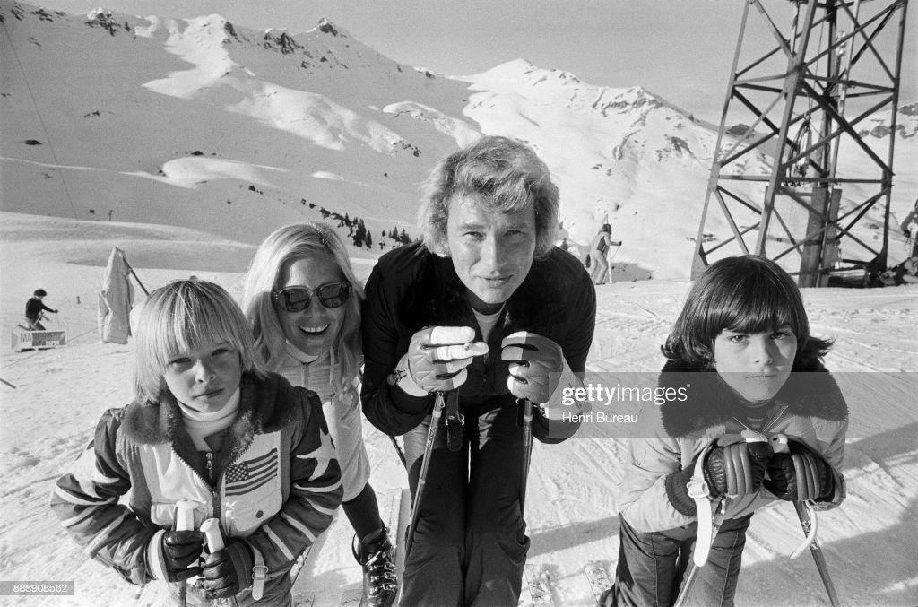 Johnny Hallyday, with his wife Sylvie Vartan and his son David Hallyday (left) on a ski trip, January 1974