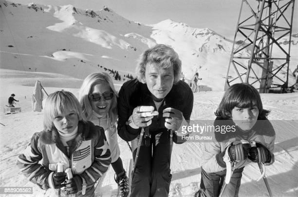 Johnny Hallyday with his wife Sylvie Vartan and his son David Hallyday on a ski trip January 1974