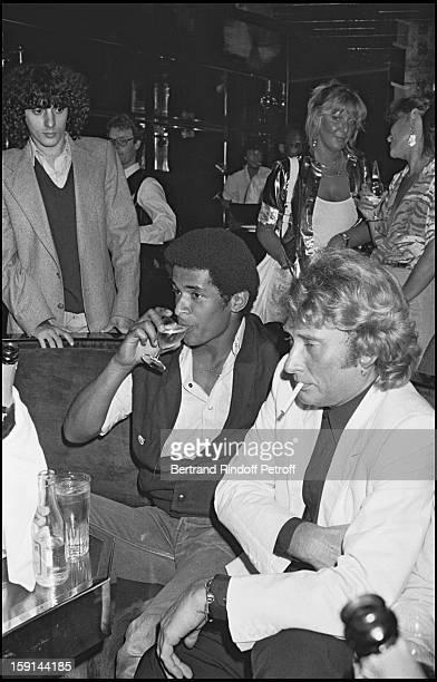 Johnny Hallyday with tennisman Yannick Noah celebrates his 38th birthday at the Elysee Matignon night club in Paris in 1981