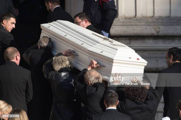 Johnny Hallyday's coffin is carried by his musicians during the Johnny Hallyday's Funeral at Eglise De La Madeleine on December 9 2017 in Paris...