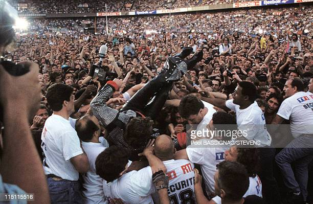 Johnny Hallyday's concert at the 'Parc des Princes' for his 50th birthday in Paris France on June 18 1993 Jumping into the crowd