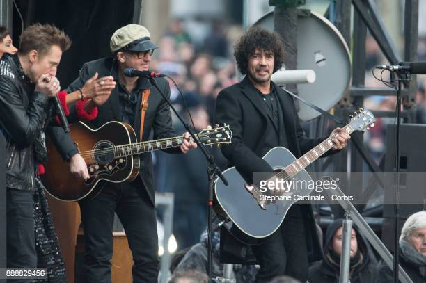Johnny Hallyday's musician and Yarol Poupaud perform during Johnny Hallyday's Funeral Procession at Eglise De La Madeleine on December 9 2017 in...