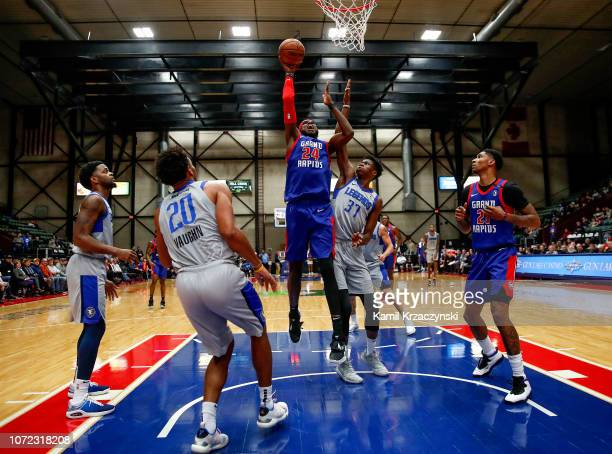 Johnny Hamilton of the Grand Rapids Drive shoots against Kostas Antetokounmpo of the Texas Legends on December 12 2018 at DeltaPlex Arena in Grand...