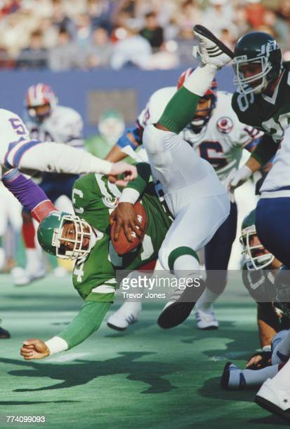 Johnny Hector Running Back for the New York Jets holds onto the ball during the American Football Conference East game against the Buffalo Bills on...