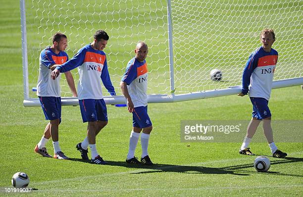 Johnny Heitinga Robin Van Persie Demy De Zeeuw and Dirk Kuyt of the Netherlands move the goal during a training session at the Wits Stadium on June 9...